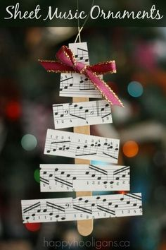 Christmas Tree Sheet Music Ornaments for Kids to Make, DIY and Crafts, Sheet Music Christmas Tree Ornaments - Happy Hooligans. Music Christmas Ornaments, Noel Christmas, Christmas Crafts For Kids, Christmas Projects, Holiday Crafts, Christmas Activities, Musical Christmas Decorations, Popsicle Stick Christmas Crafts, Christmas Sheet Music