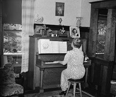 Fruit farmer's wife playing piano, Placer County, California, 1940 Vintage Photos: Russell Lee - how i picture Nora