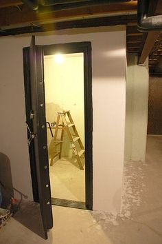Yes we built a walk in gun safe basements pinterest for How to build a safe room in your basement