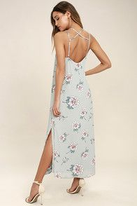 You're sure to have a magical day when you're wearing the Fine and Dandelion Grey Floral Print Romper! Grey woven poly, with a yellow and purple floral print, sweeps across a surplice bodice and long sleeves with tying cuffs. Sheer maxi skirt, with front slit, tops tailored shorts. Back keyhole with top button closure. Hidden back zipper.