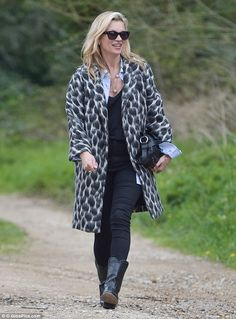 Chic in the country: Kate Moss slipped into a pretty print jacket and leather boots for a ...
