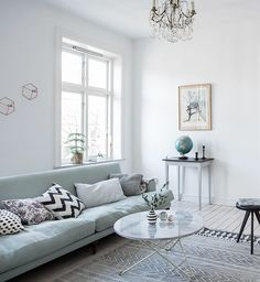 Mint green sofa in a light home - via cocolapinedesign.com