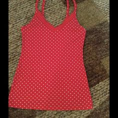 Old Navy Tank Super cute tank from Old Navy. This little cutie is red with cream polka dots. Adjustable straps and lace at neckline give you your own feminine version of the wife beater. Perfect with navy blue shorts or cutoffs, red sandals and your favorite sunnies.   Don't miss out on this little beauty. Old Navy Tops Tank Tops