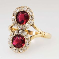 Double The Glam 2.50ct t.w. 1930's Garnet Doublet & Old Mine Cut Diamond Ring 10k | Antique & Estate Jewelry | Jewelry Finds Price: $1950.00 This outstanding early Art Deco ring is absolutely stunning and will be sure to set you apart! This unusual ring features two round cut garnet doublets with a rich red hue surrounded by twinkling chunky old mine cut diamonds.