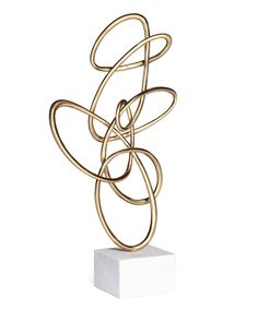 Alchemy Fine Home - This Satin brass sculpture is shaped into a curvaceously abstract form atop a white marble base.  Standing alone or displayed as a group, these gorgeous sculptures are a delight for the eyes!
