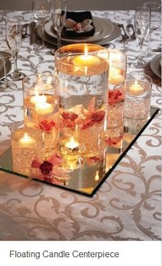 Maybe some floating candles mixed with regular pillar candles?    Floating candle centerpiece.