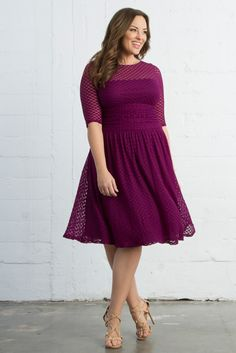 Feel the vintage vibes in our plus size Alexa Retro Dot Dress. This fun and flirty style is designed with a dotted fabric, mesh illusion neckline and 3/4 length sleeves that is both flattering and comfortable. An ideal Valentine's Day Dress for anyone who  doesn't want to wear red. Available in navy. Made exclusively for women's plus sizes. Made in the USA. Shop our entire collection of plus size cocktail dresses at www.kiyonna.com.