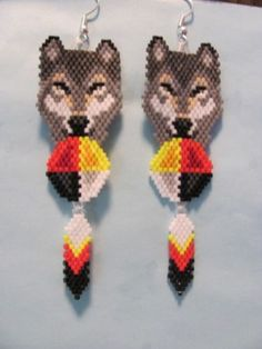 Beaded-Brown-Grey-Wolf-with-Medicine-wheel-and-feather-dangling-earrings