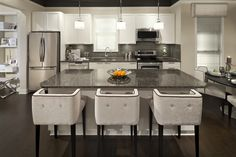 Kitchen at Breeze in South Surrey, BC | Bright, open interior with dark/light contrast colour scheme
