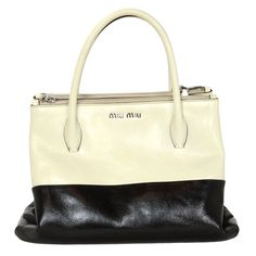 MIU MIU Black & White Two-Tone Glossed Leather Tote Bag w. Strap rt. $1,695 | From a collection of rare vintage handbags and purses at https://www.1stdibs.com/fashion/accessories/handbags-purses/