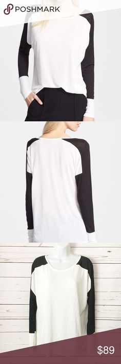 NWOT Vince. Colorblock Black & White Thin Knit Top NWOT Vince. Top. Colorblock style. True to size. 80% rayon, 20% polyester. Retails at $225 / sold out online. Vince Tops Tees - Long Sleeve