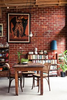 Rustic wooden furniture and exposed brick wall - industrial dining room