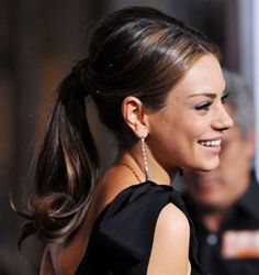 she would not do the ponytail often, but when she would, well, sit down, kunis.