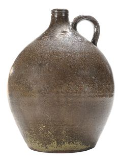 Daniel Seagle Stoneware Jug like the ones on the mantel of the huge fireplace in the big den