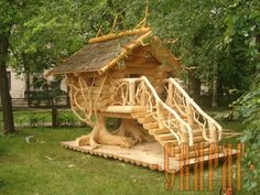 a rustic, but amazing playhouse for the kids.