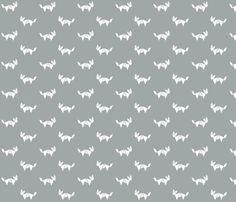 tangram fox in white on gray fabric