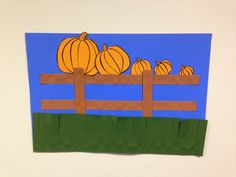 5 little pumpkins sitting on the fence craft