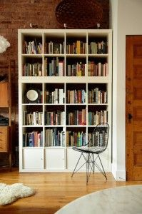 modern-perfumer-house-with-vintage-white-wooden-bookcase-library-metal-chair-brick-wall-and-wood-floor-style