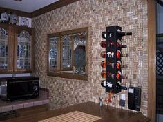 Wine cork wall covering. Marsha, you would have enough corks to do this in no time!