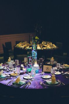 One of two wedding centerpieces. Color scheme: Purple and Tiffany Blue - Photo by: Chernivsky Weddings