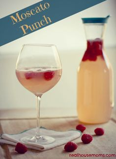 Moscato Punch combines wine, pink lemonade, Sprite Zero, and fresh raspberries for a sweet, fruity, and refreshing drink. It is perfect for girl's night!