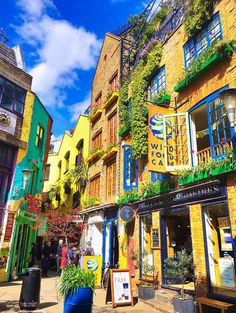 Neal's Yard, London. A secret courtyard in the colorful Covent Garden of London. http://www.kevinandamanda.com #travel #london #color