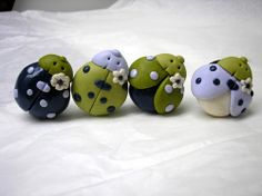 Green ladybugs from polymer clay.