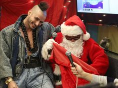 Singer Cole Whittle of DNCE receives a gift from Santa during The Elvis Duran Morning Show in New York. Cole Whittle, Morning Show, Whittling, Joker, Santa, Singer, York, Celebrities, Gift
