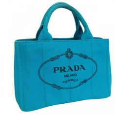 This authentic PRADA Tote Bag is made from turquoise canapa. The bag opens to a matching interior. Find more at https://www.swayy.com.au/
