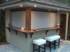 Talius Rollshutters installed out outdoors bar to provide security and weather protection. (closed) : Talius Rollshutters installed out outdoors bar to provide security and weather protection. Backyard Bar, Backyard Kitchen, Patio Bar, Backyard Patio Designs, Backyard Retreat, Diy Outdoor Bar, Outdoor Kitchen Bars, Outdoor Sheds, Pool House Shed