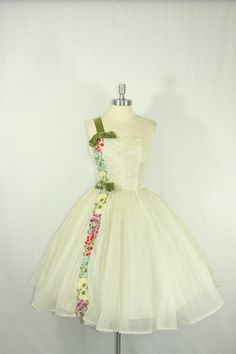 vintage 50's embroidered floral tea length wedding dress $320. i think I'd like it better without the bows and strap, or if the green was the trim all the way around.