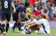 A moment of true sportsmanship.  France's Camille Abilly is consoled by Japan's Aya Miyama after Japan defeated France in the women's semi-final soccer match at Wembley Stadium in London at the London Olympic Games, on Aug. 6.