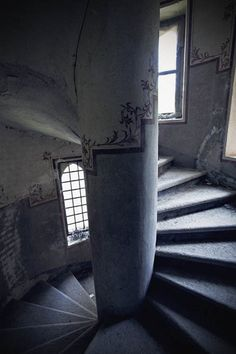 one staircase inside the abandoned Castle in Italy.  This castle's foundations were built in 1170, mainly used for military functions until it became a noble house before it was abandoned and left to ruin.