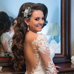 Our gorgeous bride Andrea looking fab in her crystal encrusted bridal comb and Galia Lahav wedding gown! #elegantbride #realbride