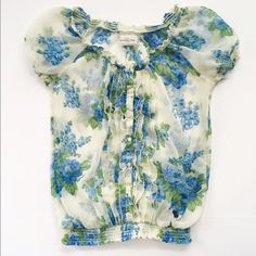 Abercrombie Top Lovely sheer top with blue and green floral print. Size small from Abercrombie and Fitch. Smocking at neckline and waistlines. Excellent condition. Abercrombie & Fitch Tops Blouses