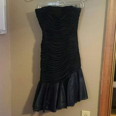 Morton Myles black evening dress Morton Myles for the Warrens: black, ruched body, asymmetrical layered skirt, strapless, size 6. Very good condition with no tesrs, tugs, or frayed...was bought from consignment and used once as a prom dress. Morton Myles  Dresses Strapless