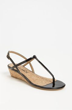 Simple, elegant sandals in a neutral color and with a small wedge heel add extra height for dinner while staying comfortable. #suitcasestyle