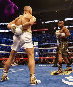 """Sports Illustrated's 100 Best Photos of 2017 - December 14, 2017:  FLOYD MAYWEATHER, CONOR MCGREGOR (LEFT) 