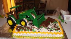Homemade John Deere Clean Up Cake: This John Deere Clean Up Cake was baked by myself for my Grandson Caleb's first birthday.  It is a sheet cake with home made buttercream icing.  I could