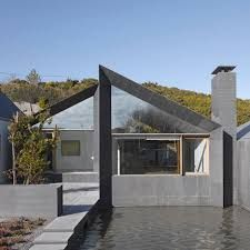 Lovely courtyard & pond/pool for this modern stone rural house at Goleen (south coast of Ireland) by London firm Niall McLaughlin Architects. (I usually prefer long & low, but the pitched roof here is, well, pitch perfect. Residential Architecture, Modern Architecture, Roof Extension, Extension Google, Small Buildings, House Extensions, Flat Roof, Deco, Building A House