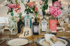 Pretty Country Gin Themed Wedding- Pretty Country Gin Themed Wedding Table Centre Number Wood Slice Stencil Bottles Blooms Floral Flowers Setting Pretty Country Gin Wedding www. Wedding Table Centres, Wedding Table Centerpieces, Wedding Decorations, Centrepieces, Quirky Wedding, Diy Wedding, Wedding Flowers, Wedding Ideas, Elegant Wedding
