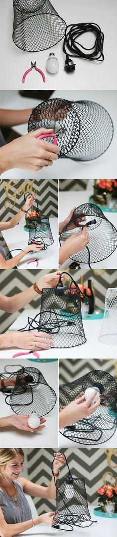 Lámpara DIY a partir de una cesta meetálica / Via http://www.inspiredbythis.com/:
