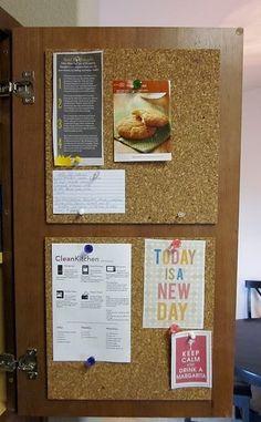 Corkboard on the inside of a pantry door .  Great idea!