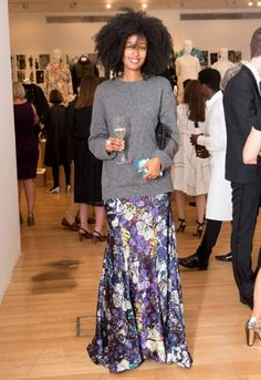 Julia Sarr-Jamois in a chunky knit and a metallic maxi skirt