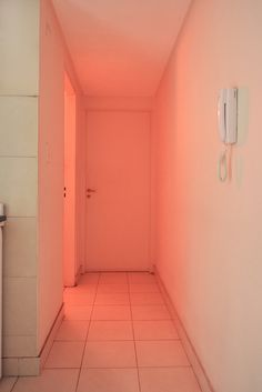 // haha, the phone is for emergency calls, when the pink starts moving down the hall... i actually had an apartment once with a square hall in the middle, all rooms had wall paint in a different color that glowed into the hallway, it was magical
