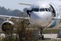 Cyprus state TV says #EgyptAir hijacker surrendered: http://reut.rs/1qdNyy2