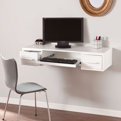 Save some space in your work area with this wall mount desk. Providing an ample writing surface, this desk helps keep your work organized with a pull-out tray, two drawers and cord management outlet.                                                                                                                                                                                  More