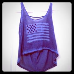 American flag crop top Gorgeous blue color crop top with an American flag on front. The stars are sewn on (see last pic) and there's a cute back detail. Super soft and perfect for the 4th of July! Jessica Simpson Tops Crop Tops
