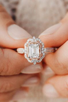 Emerald cut diamond with unique halo. Rose gold.