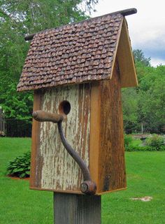 Bird House Made is Rome Maine  Run By Mark, Started to help Handicap people build self worth Run $65.00 and Up all hand made. Roof is made out of Pine cone pedals very time consuming,but this is what gives originality and value to this one of kind gift.